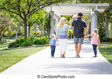 Young Caucasian Family Taking A Walk In The Park