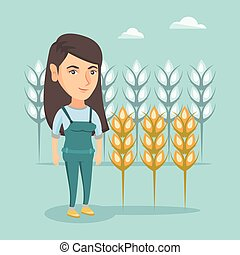 Young caucasian farmer standing in a wheat field. - Young...