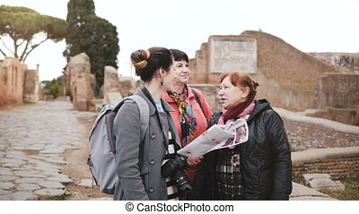 Young Caucasian female excursion tour guide giving detail on...