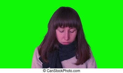 Young caucasian girl caught cold on green screen - Young...