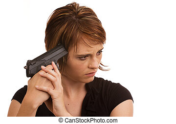 Young Caucasian girl holding gun against her head