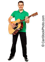 Young caucasian guitarist playing tracks isolated over white...