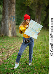 young caucasian hiker looking at map and try to find a way