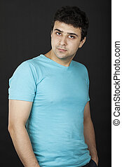 Young caucasian man in blue t-shirt