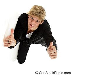 Young caucasian man lying sideway, thumbs up