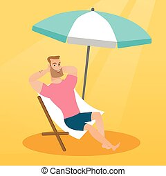 Young caucasian man relaxing on the beach chair.
