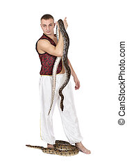 Young Caucasian Man with snakes - Young Caucasian man in...