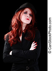 Young caucasian redhead woman in business jacket and hat