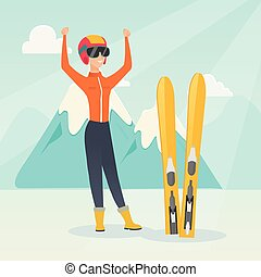 Young caucasian skier standing with raised hands.