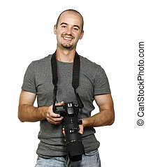 young caucasian smiling photographer on white background