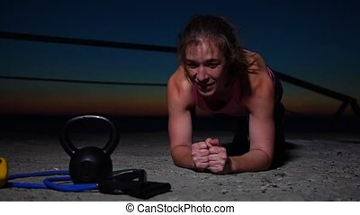 Young Caucasian Sportswoman Working Out at Sunset. Fitness...