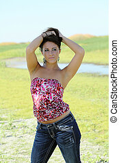 Young caucasian teen girl outdoors in jeans and top
