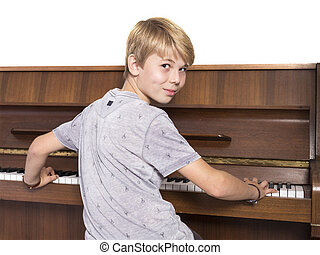 young caucasian teen plays the piano