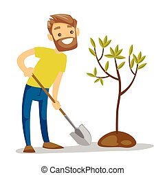 Young caucasian white gardener plants a tree.