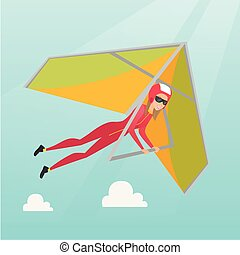 Young caucasian woman flying on hang-glider.