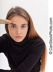 young caucasian woman in black turtleneck isolated on white background