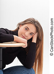 young caucasian woman in turtleneck and blue jeans isolated on white background