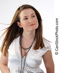 Young caucasian woman in white blouse and necklace
