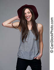 Young caucasian woman laughing with red hat