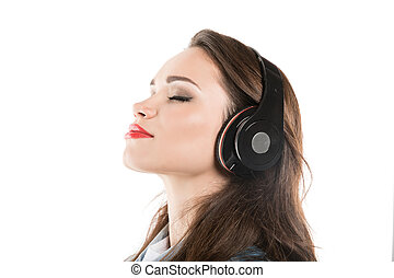 young caucasian woman listening music in headphones isolated on white
