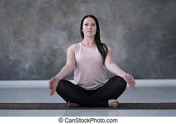 Young caucasian woman meditating on the floor