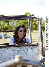 young caucasian woman outdoors playground smiling portrait