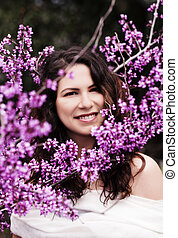 Young Caucasian Woman Outdoors Portrait Amid Purple Blossoms