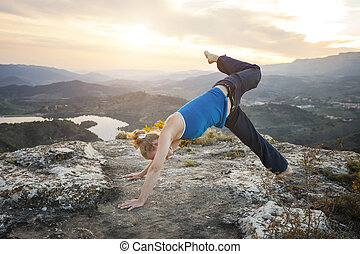 Caucasian woman performing downward dog yoga pose