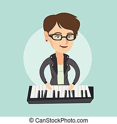 Young caucasian woman playing the piano.