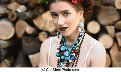 Young caucasian woman pose with stack of wood - Young...