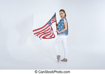 young caucasian woman posing and waving USA flag, Independence Day Celebration