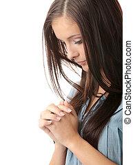 Young caucasian woman praying - Closeup portrait of a young...