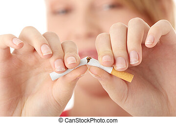 Young caucasian woman quiting smoking isolated on white...