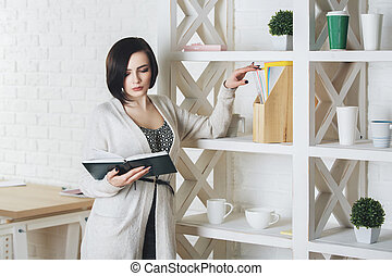 Young caucasian woman reading book