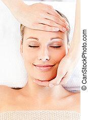 Young caucasian woman receiving a head massage