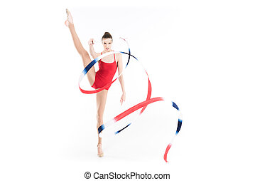 young caucasian woman rhythmic gymnast performing with colorful rope
