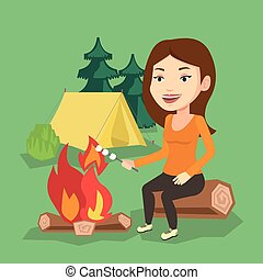 Woman roasting marshmallow over campfire. - Young caucasian...