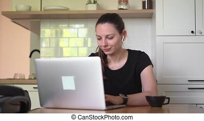 Young caucasian woman using laptop at home office. Reading great news, winning lottery, successful entrepreneurs. Online money
