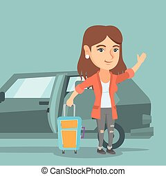Young caucasian woman waving in front of car. - Caucasian...