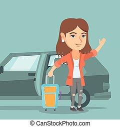 Young caucasian woman waving in front of car. - Caucasian...