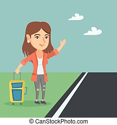 Young caucasian woman with a suitcase hitchhiking.