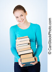 Young caucasian woman with books