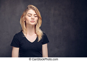 Young caucasian woman with closed eyes