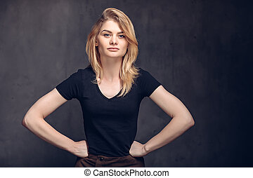 Young caucasian woman with hands on hips