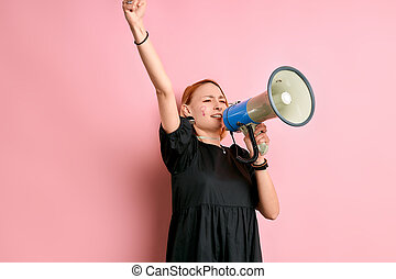 young caucasian woman with megaphone
