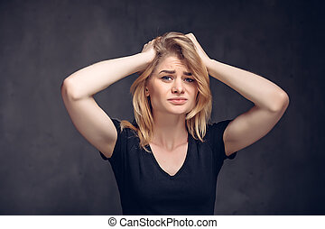 Young caucasian woman with migraine