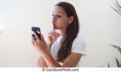 Young caucasian woman with phone. Censorship in internet.