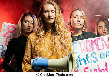 young caucasian women activist holding posters