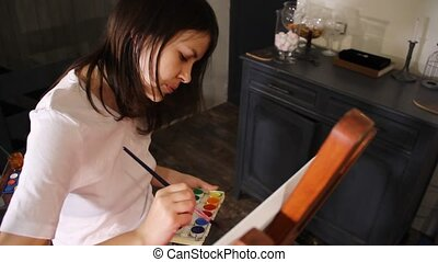 woman artist painting - young caucassian woman artist...