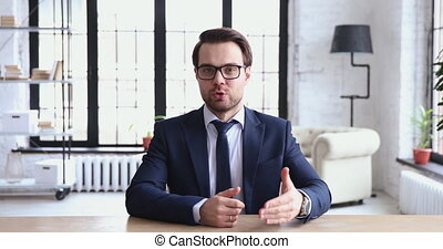 Young ceo speaking to camera recording business video ...